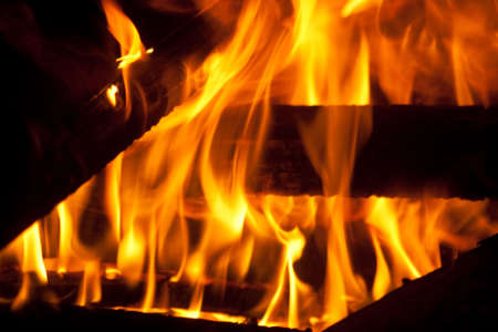 A warm fire showing the flames dancing around photo