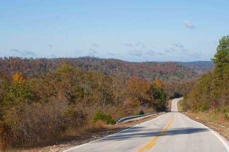 A two lane highway through the Ozark mountains. photo