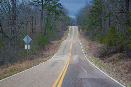 A rural highway under a cloudy sky. photo