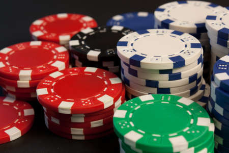 Colorful poker chips stacked up. photo