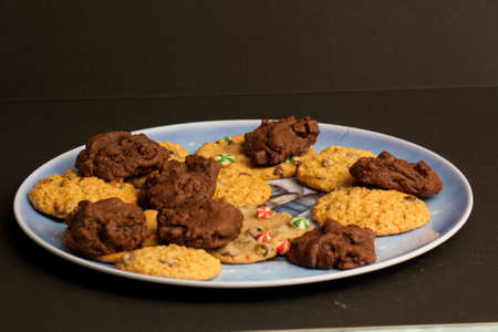 A plate of different types of Christmas cookies.