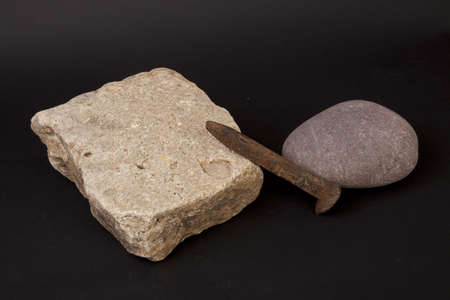 Stones with a chisel on a black background. Stock Photo