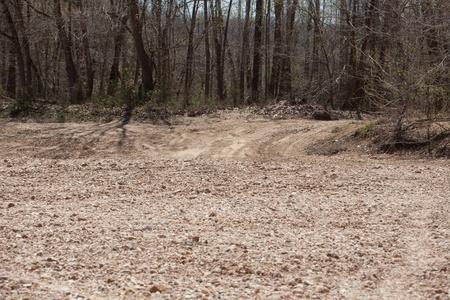 A rural dirt road through the woods. photo