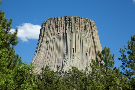 Devils Tower rising into the sky. photo
