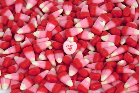 candy corn: Valentines candy corn with a candy heart. Stock Photo