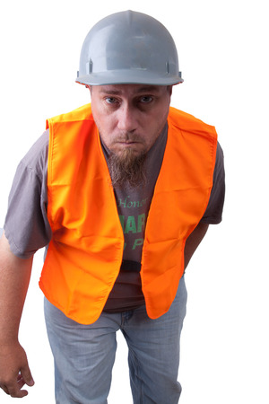 leaning forward: A construction worker leaning forward.