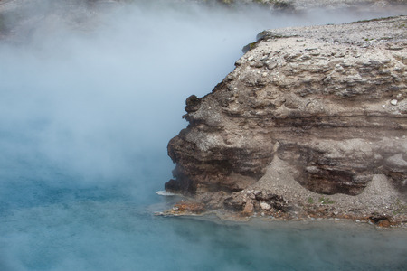 excelsior: A boulder sticking our of the Excelsior Geyser Crater. Stock Photo