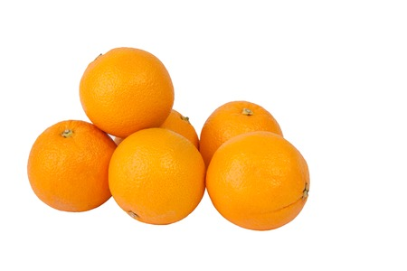 heap: A group of oranges isolated on a white background. Stock Photo