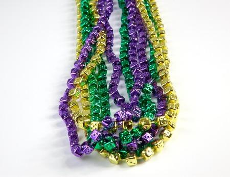 Mardi Gras beads on a white background. photo