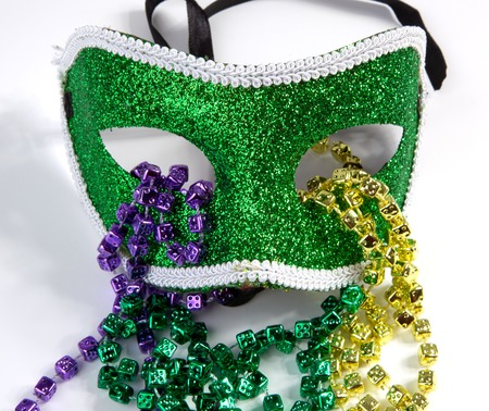 mardi gras mask: A Mardi Gras mask with beads on a white background. Stock Photo