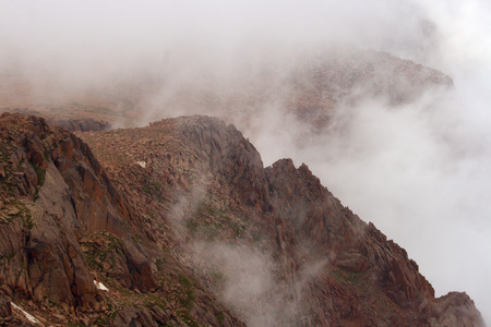 mountaintop: A cloud covered mountaintop at Pikes Peak Colorado.