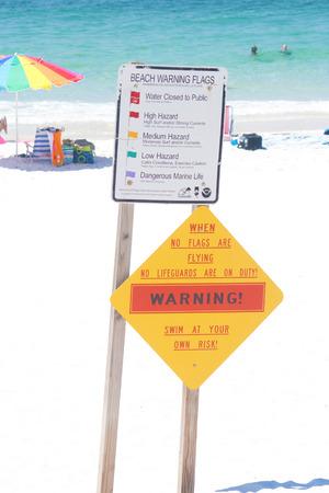 warning signs: Two warning signs at a Florida beach.