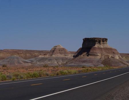 A mesa beside an empty highway.