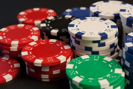 stacked up: A group of colorful poker chips stacked up.