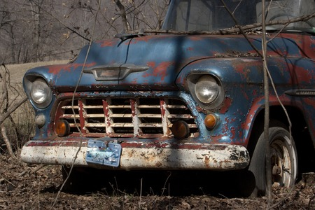 chevy: An old Chevy Truck sitting abandoned.