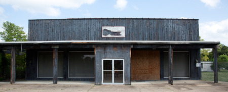 boarded up: A front view of an old boarded up abandoned building. Stock Photo