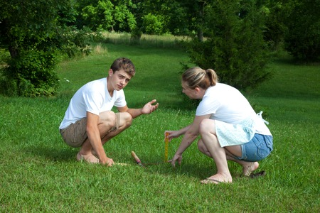 yard work: A teenage boy and woman doing yard work.