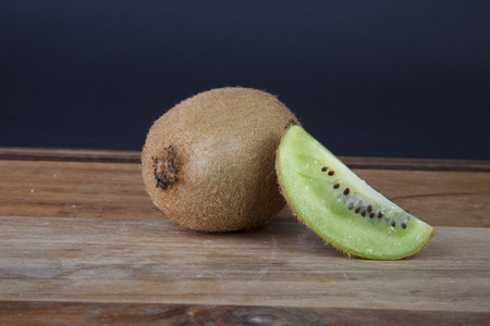 wedge: A wedge of kiwi propped up by a whole kiwi. Stock Photo
