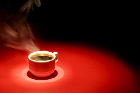 Coffee cup over red black background Stock Photo