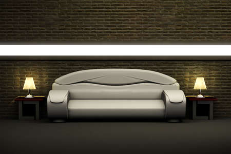 sofa and two tables with lamps over the brick wall photo