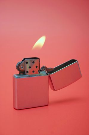 lighter: Opened lighter on the red background Stock Photo