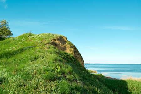 bullrush: The hill ashore sea. Stock Photo