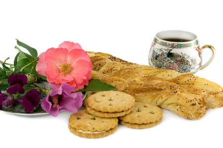 The cup coffee, cookie and flowerses. photo