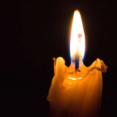 easter candle is burning: Church candle on a black background.