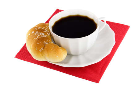 The cup coffee, croissant on red napkin. photo