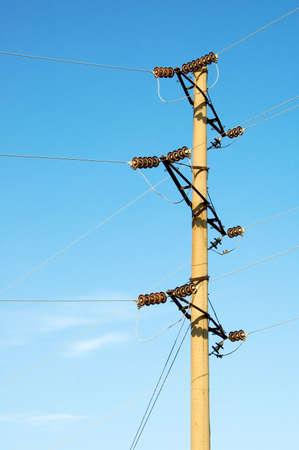The electric pylon on background sky. photo
