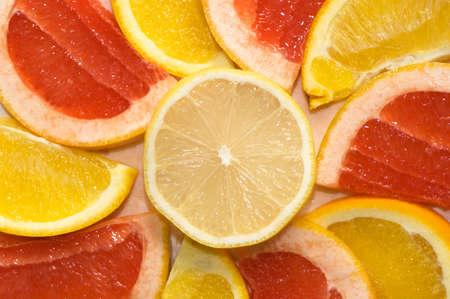 lemony: Fruit background from a lemon, orange, grapefruit.