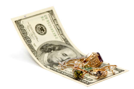 Gold ornaments and dollars isolated on a white background. photo