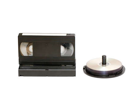 videocassette: Videocassettes and computer disks isolated on white Stock Photo