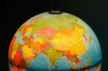 terrestrial globe on black background photo