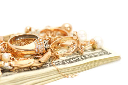 silver jewellery: Gold ornaments and dollars isolated on a white background.