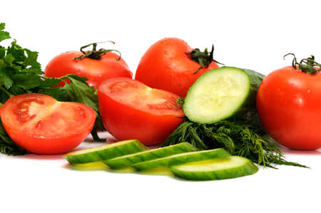 Tomatoes, cucumber and parsley isolated on a white background photo