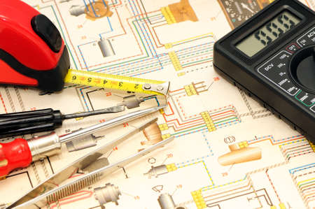 schematic: Tools on a background of the electric scheme