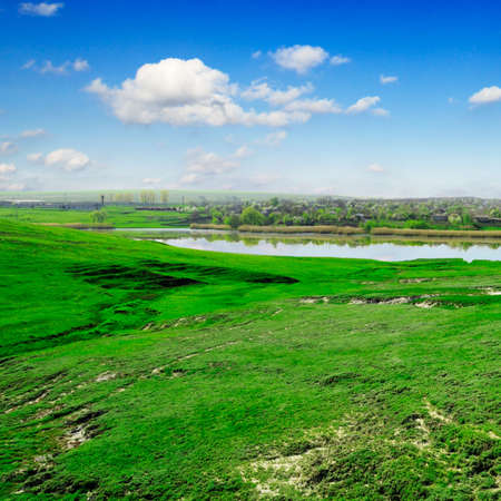 Lake, green grass, blue sky                                     photo