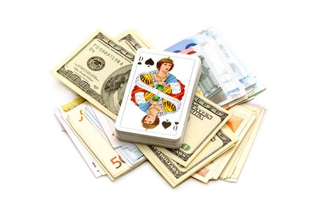 money and playing cards isolated on a black background