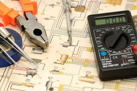 elevation meter: Tools on a background of the electric scheme