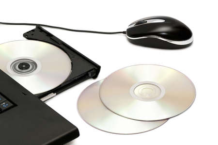 minicomputer:  computer disk drive and mouse isolated on a white background                                    Stock Photo
