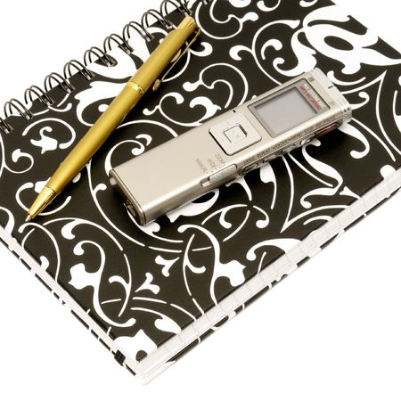 dictating: Dictaphone, notepad and ballpen on white background                                     Stock Photo