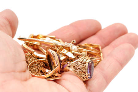 pendent: Gold ornaments in a hand