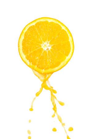 fluye hacia abajo a partir de jugo de naranja Foto de archivo