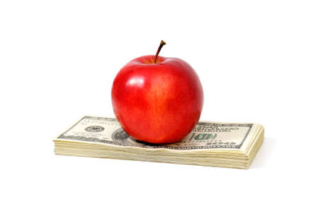 apple and dollars isolated on a white background Stock Photo - 4292536