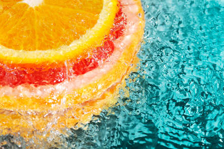 orange and grapefruit in streaming water photo