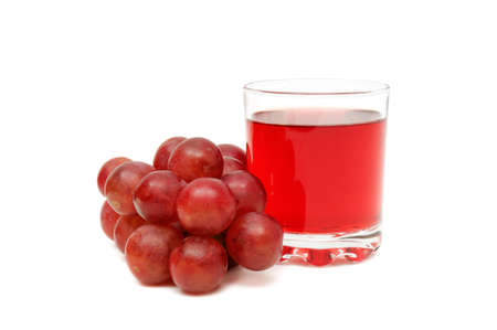 Glass with juice and grapes isolated on a white background photo