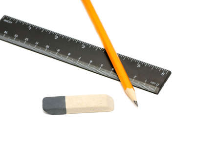 Pencils, eraser and ruler on a white background Stock Photo - 4616784