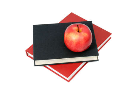 red apple on a book isolated on white photo