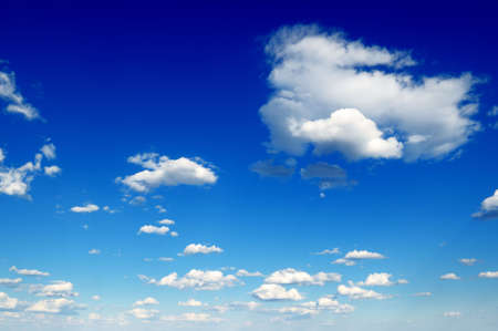cumulus: white fluffy clouds in the blue sky